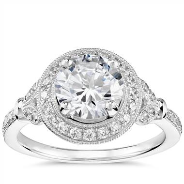 Vintage floral halo diamond engagement ring set in platinum at Blue Nile