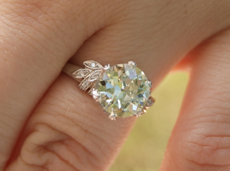 vintage style diamond ring on the hand