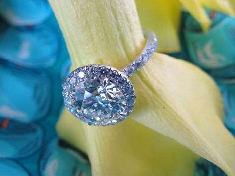 Hearts and Arrows diamond halo ring