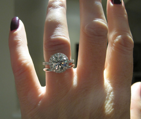 Hearts and Arrows diamond halo ring on the hand