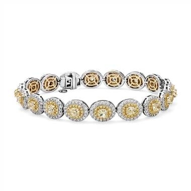 Fancy yellow diamond halo bracelet set in 18K white and yellow gold at Blue Nile