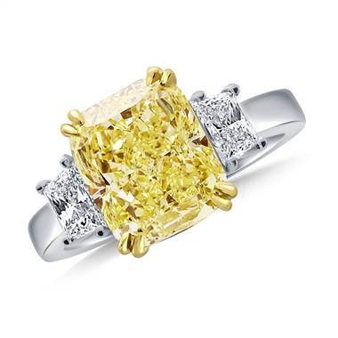 Fancy yellow cushion cut diamond three stone ring set in 18K white gold at B2C Jewels