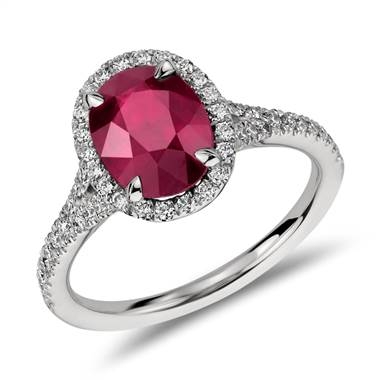 Oval ruby and diamond halo ring set in platinum at Blue Nile