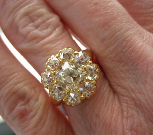 Kaleigh's heirloom ring with antique cushion diamonds