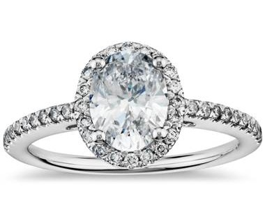 Oval diamond halo engagement ring set in 14K white gold at Blue Nile
