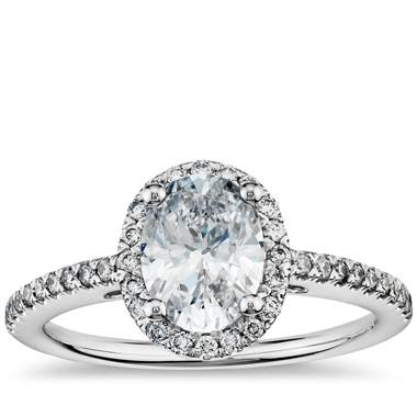Oval halo diamond engagement ring set in 14K white gold at Blue Nile