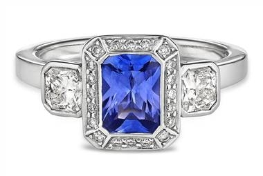 Three-stone diamond and emerald cut sapphire halo ring set in platinum at Ritani