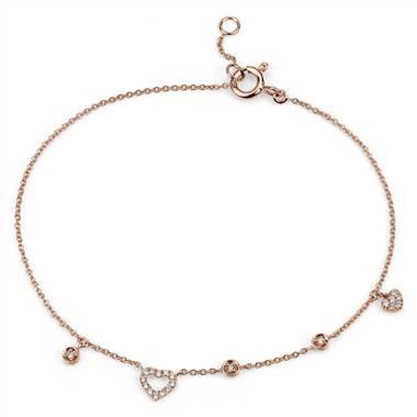 Mini diamond asymmetrical heart bracelet set in 14K rose gold at Blue Nile
