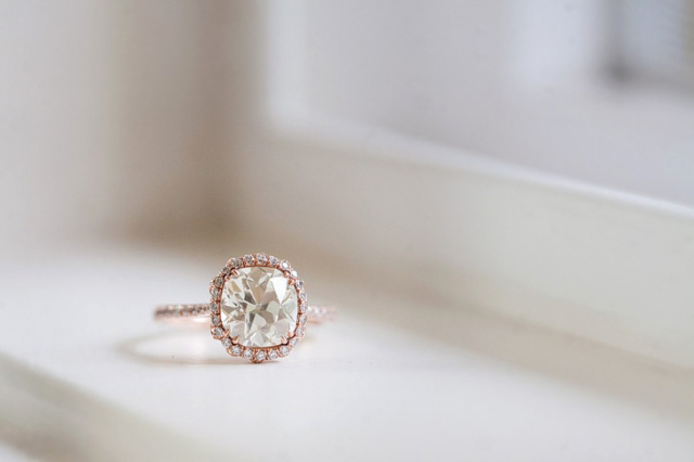 Custom diamond halo engagement ring in rose gold