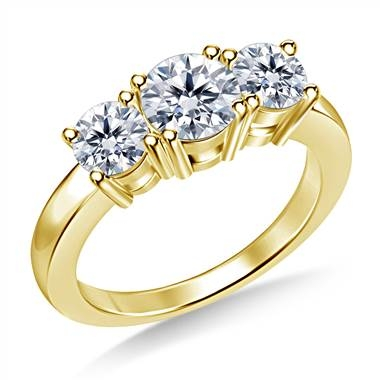 Top: Three stone round diamond engagement ring set in 18K yellow gold at B2C Jewels