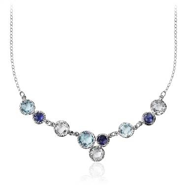 Sky blue topaz, white topaz and iolite bib necklace set in 14K white gold at Blue Nile