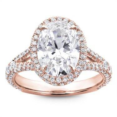 Three row pave engagement ring setting set in 18K rose gold at Adiamor