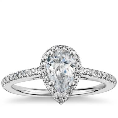 Pear shaped halo diamond engagement ring set in 14K white gold at Blue Nile