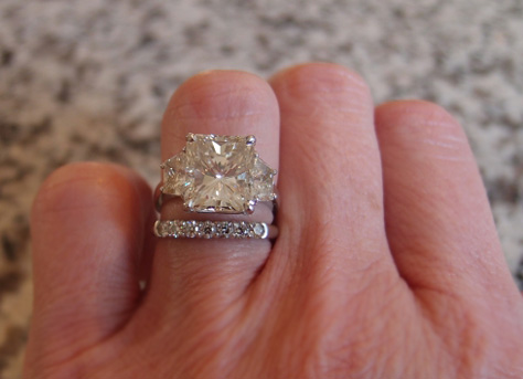 5 carat radiant cut diamond ring on the hand