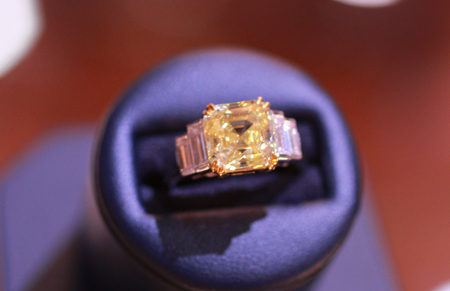 Fancy intense yellow royal asscher cut diamond ring weighing 4.38 carats