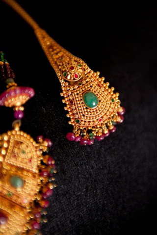Gold earrings with emerald and ruby cabochons