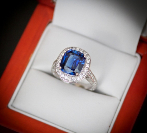 Sapphire engagement ring with diamond a halo