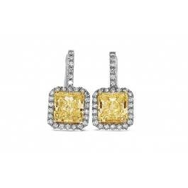 Radiant cut yellow diamond earrings set in 18K white gold at I.D Jewelry