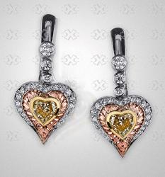 Fancy yellow heart-shaped ajour earrings by Victor Canera