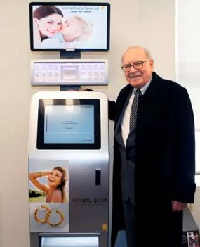 Warren Buffett stands next to the Precious Express Kiosk