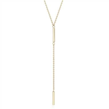 A delicate lariat necklace will highlight your stunning collarbones. Double bar lariat-Y necklace set in 14K yellow gold at Blue Nile