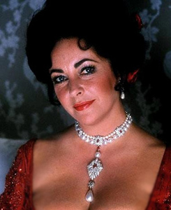Elizabeth Taylor wearing Cartier Ruby Necklace with La Peregrina Pearl