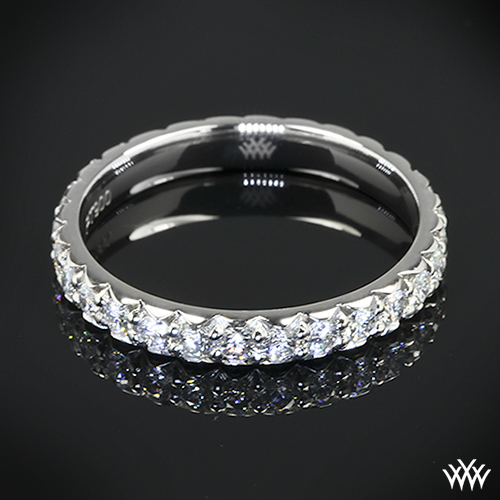This exquisite Custom Diamond Wedding Ring is set in platinum and holds
