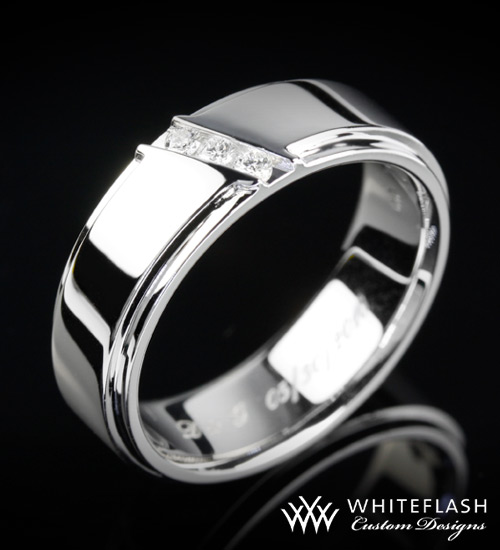 This custom made men 39s wedding band is set in 14 carat gold and the diagonal