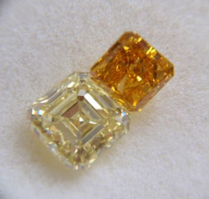 Fancy vivid yellow orange diamond with .93ct fancy light yellow diamond