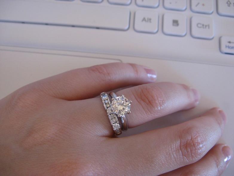 1.5 carat princess cut diamond ring on hand