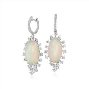 Opal and diamond sunburst drop earrings set in 18K white gold at Blue Nile