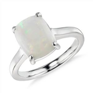 https://www.pricescope.com/jewelry/right-hand-rings/opal-cushion-cocktail-ring-in-14k-white-gold-10x8mm-42520