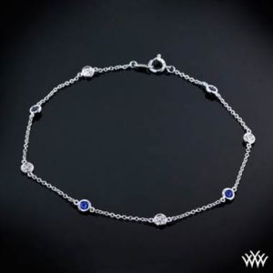 """Color Me Mine"" diamond and blue sapphire bracelet set in platinum at Whiteflash"