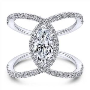 Diamond halo engagement ring set in 14K white gold at Gabriel & Co