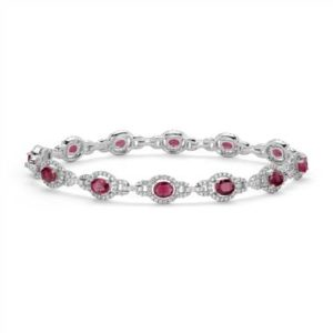 Ruby and diamond halo bracelet set in 14K white gold at Blue Nile