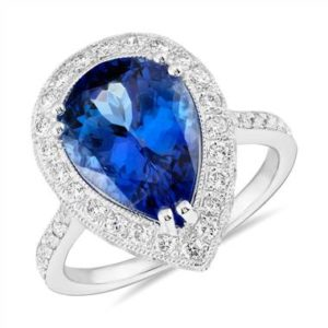 Pear-shaped tanzanite and diamond halo cocktail ring set in 18K white gold at Blue Nile