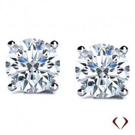 Round diamond stud earrings set in 14K white gold at I.D. Jewelry