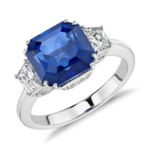 Soulmate Pairing: Blue sapphire and diamond three-stone ring set in 18K white gold at Blue Nile