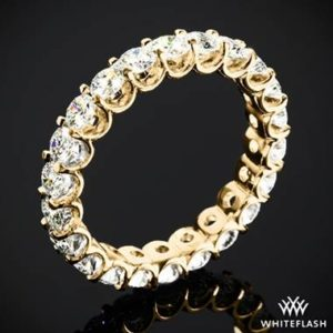 Annette's U-prong eternity and diamond wedding ring set in 18K yellow gold at Whiteflash