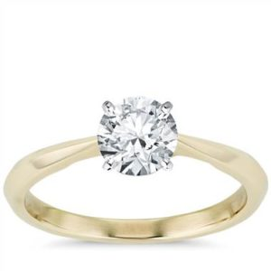 Truly Zac Posen knife-edge solitaire engagement ring set in 14K yellow gold at Blue Nile
