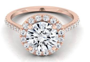 Diamond round halo engagement ring set in 14K rose gold at RockHer
