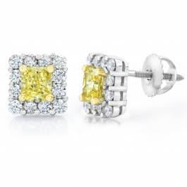 Fancy yellow diamond earrings set in platinum at I.D. Jewelry
