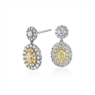 Fancy yellow diamond halo drop earrings set in 18K white and yellow gold at Blue Nile (