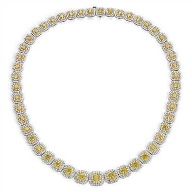 Fancy yellow diamond double halo eternity necklace set in 18K white and yellow gold at Blue Nile