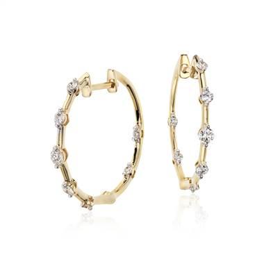 Studio diamond hoop earrings set in 18K yellow gold at Blue Nile