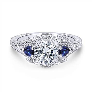 Vintage 14K white gold diamond and sapphire three stone halo engagement ring at Gabriel & Co.