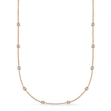 Show you're anything but a damsel in distress by wearing this bezel set diamond station necklace set in 14K rose gold at B2C Jewels