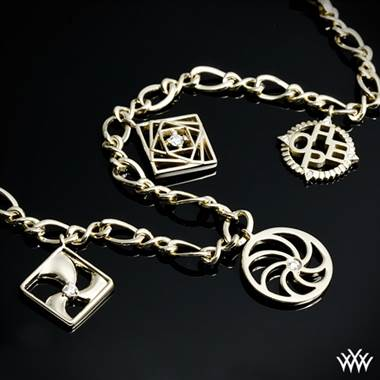 Awear diamond charm bracelet with four charms included set in 14K yellow gold at Whiteflash