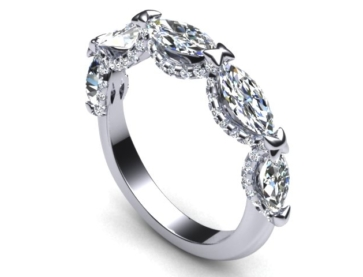 TaraMSP originally posted her incredibly unique wedding band on the Show Me the Bling forum at PriceScope. This is such a great looking wedding band! I look at a lot of jewelry, and I can't recall seeing anything exactly like this. I just kept coming back to look at this again, so I wanted to show you all too.