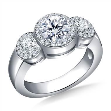 Three stone halo diamond engagement ring set in platinum at B2C Jewels